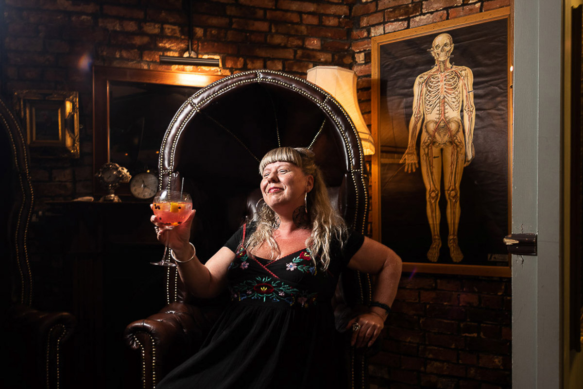 female with large gin and tonic in alternative pub