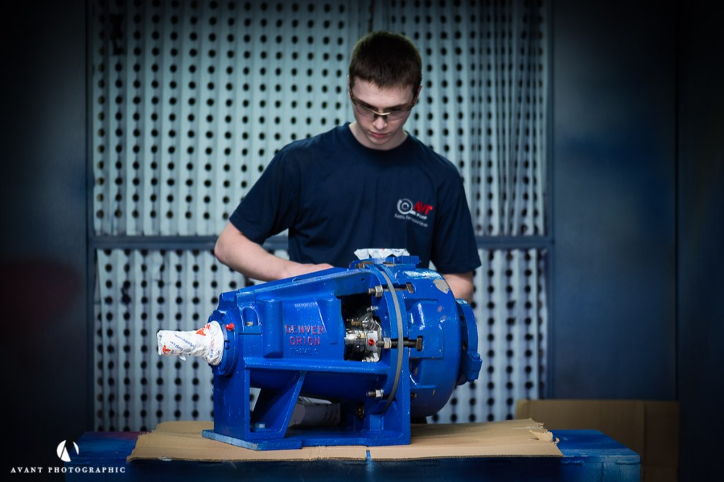 Avant Commercial photographer Phil Burrowes Pump engineer services a pump at AVTPUMP