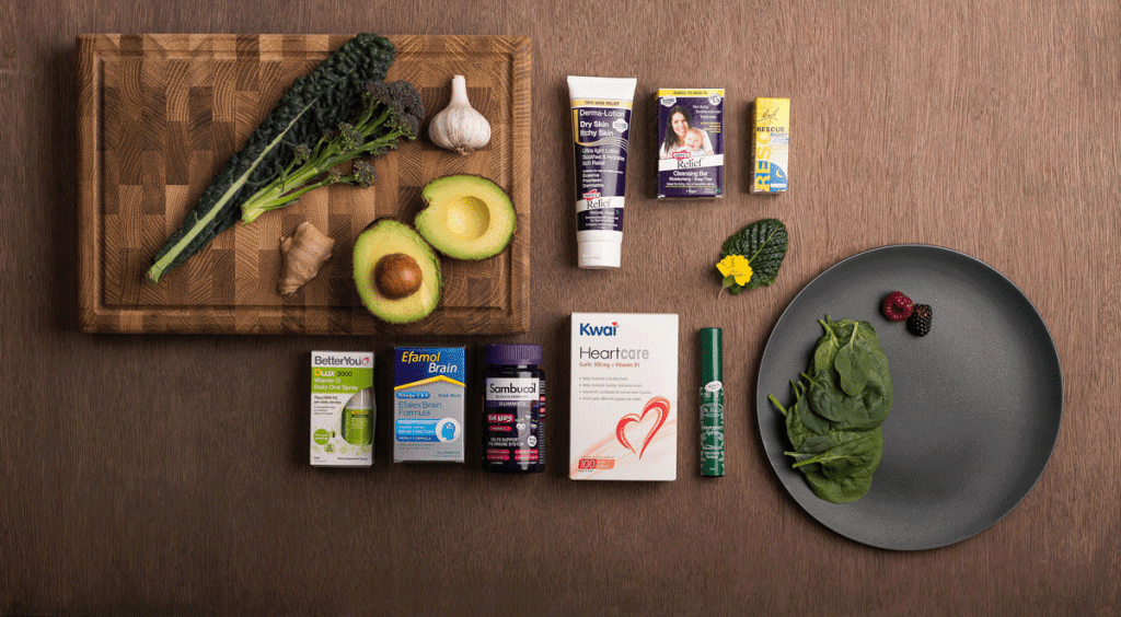Flat lay of health foods and natural ingredients with health products on dark background