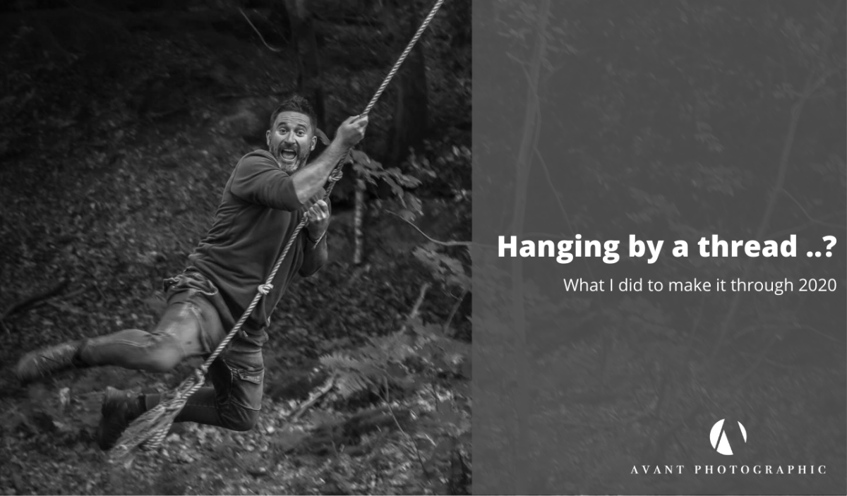 Phil on a ropeswing black and white