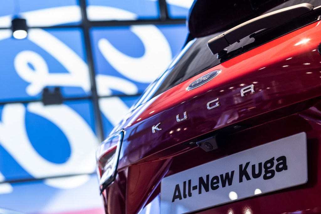 Car sales franchise photography of red Ford Kuga rear