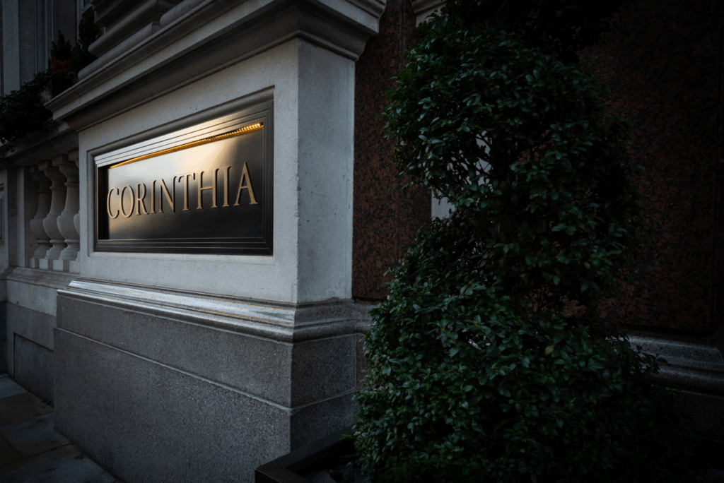 Avant Commercial photographer Phil Burrowes Exterior, dramatically lit shot of Corinthia London, a restaurant where Signaserv service the doors.