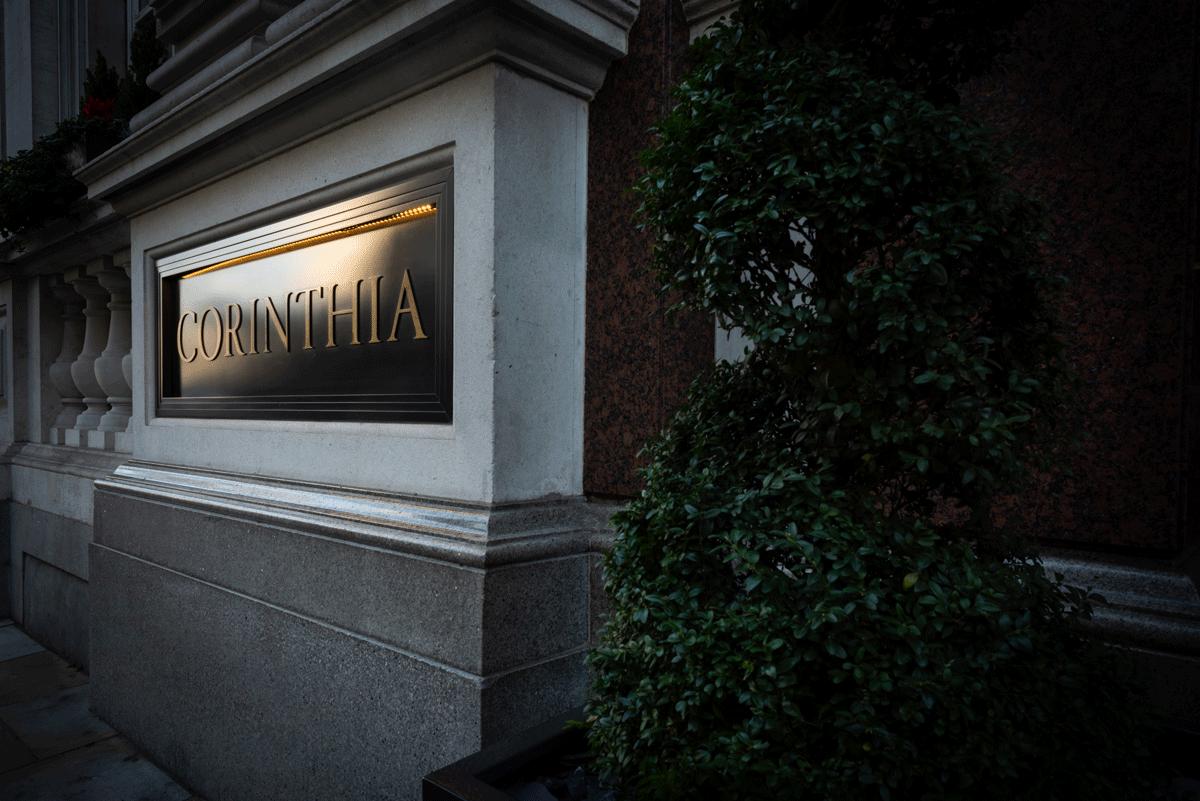 Avant Commercial photographer Phil Burrowes Corinthia London exterior signage lit by sunset