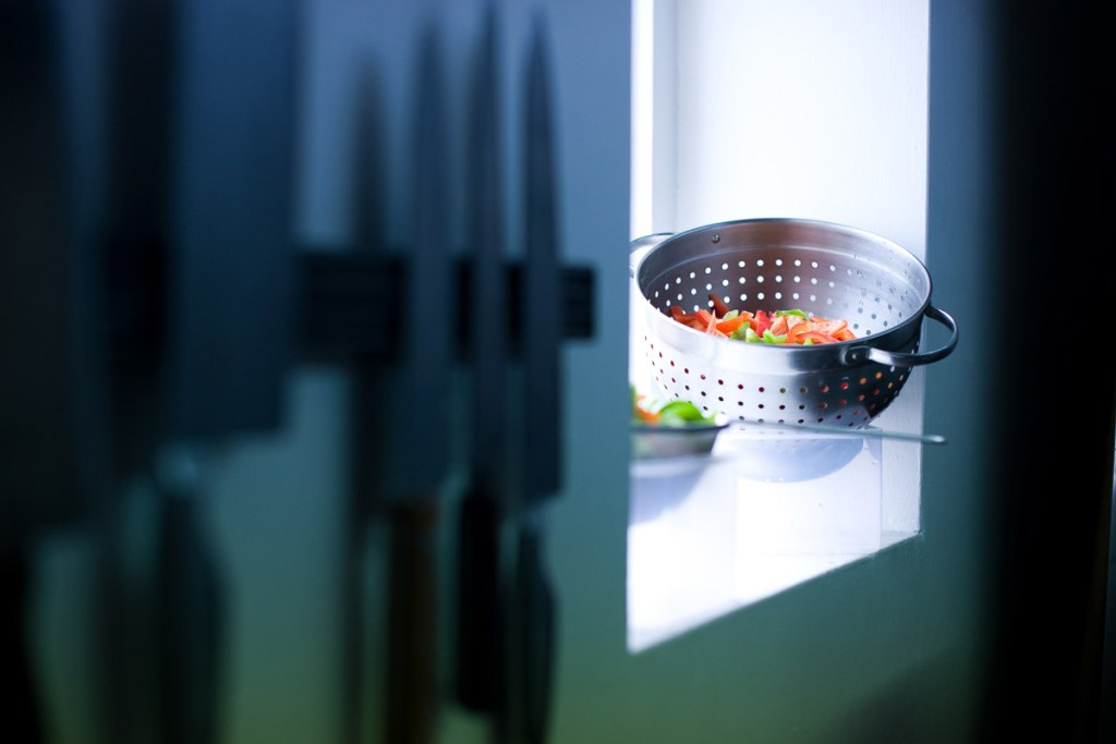 Avant Commercial - Stock Photography - Alternative to Stock photography for business - A set of prepped vegetables on a windowsill with knives in foreground